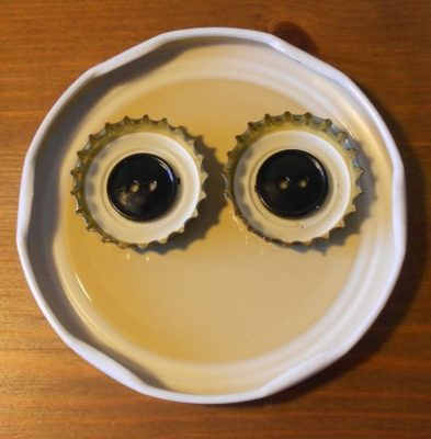 Poniendo botones como pupilas